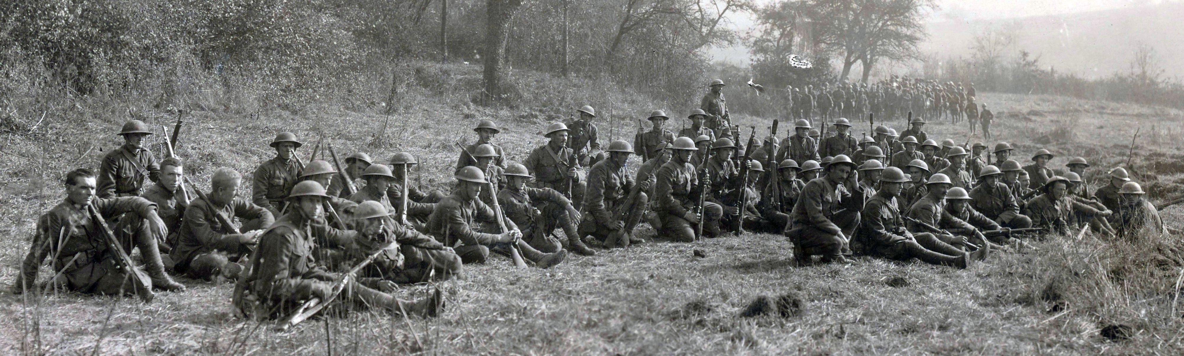 Survivors of the Lost Battalion's ordeal rest after being rescued. National Archives.