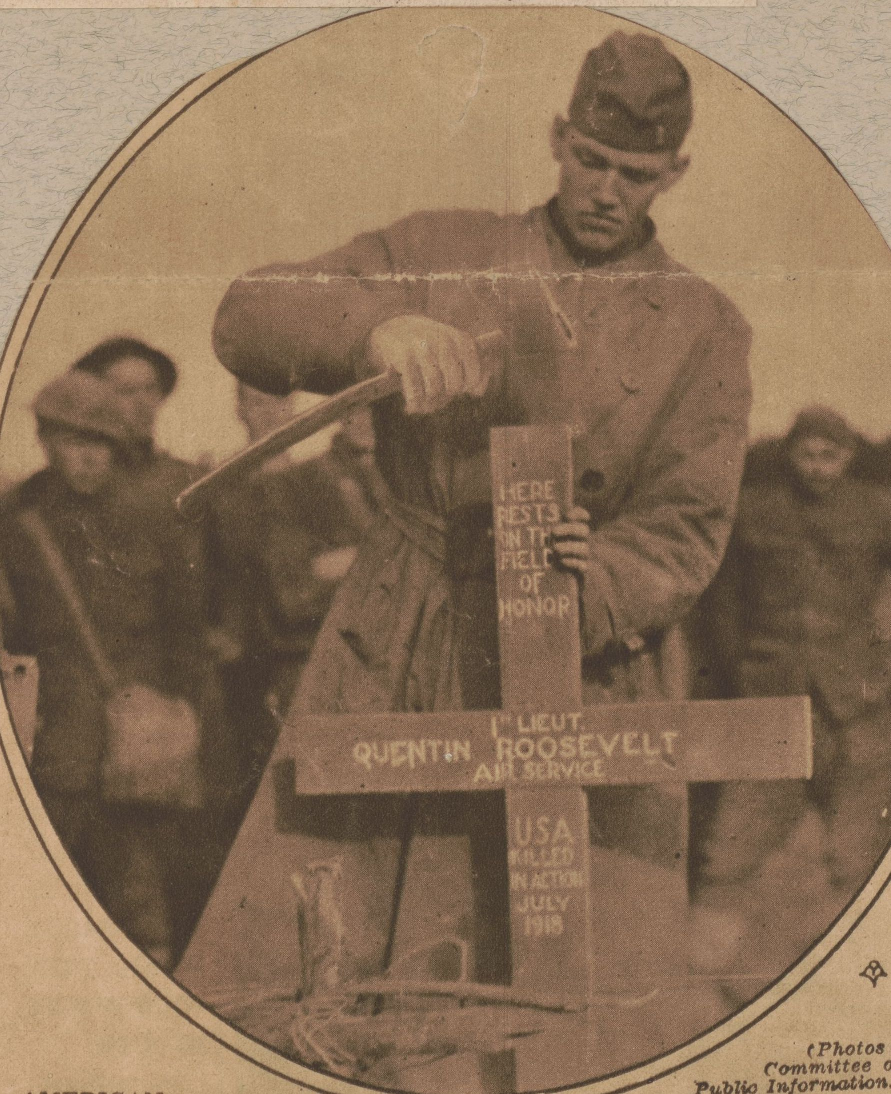 A German soldier hammers on the marker for Lt. Quentin Roosevelt's temporary grave.