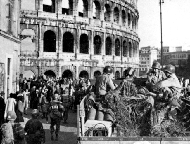 A convoy of American troops passes the Coliseum in Rome after the city was liberated on June 4, 1944.