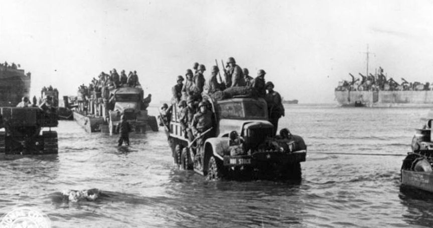 Troops and equipment come ashore at Anzio. National Archives.
