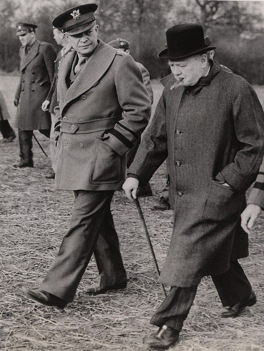 General Dwight Eisenhower, and Prime Minister Winston Churchill inspect preparations for the D-Day invasion.