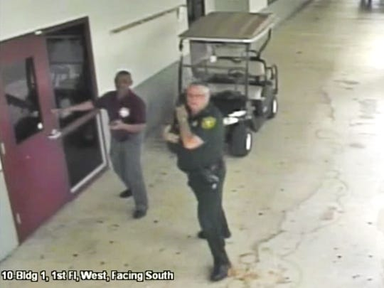 More school guards may be of limited help. Resource officer Scot Peterson (right) remained outside during the shooting at Marjory Stoneman Douglas High School. Photo Broward County Sheriff's Office.