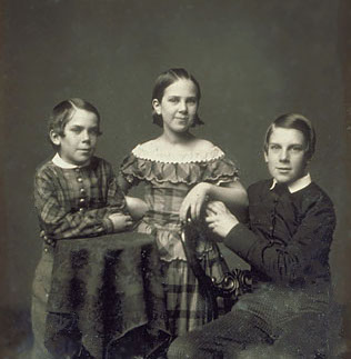 "Holmes (right) and his siblings were born into the world of wealthy ""Boston Brahmins,"" a phrase invented by their father."