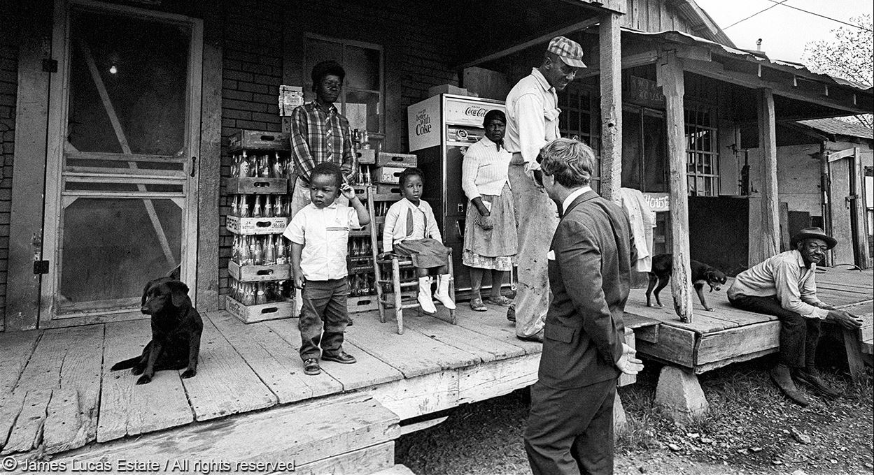 Senator Robert Kennedy visiting with a Delta family in Greenville, MS on April 11, 1967. Photo: Jim Lucas.