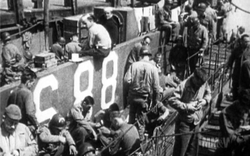 Crew and soldiers aboard LCIL-88 wait before heading to Normandy.