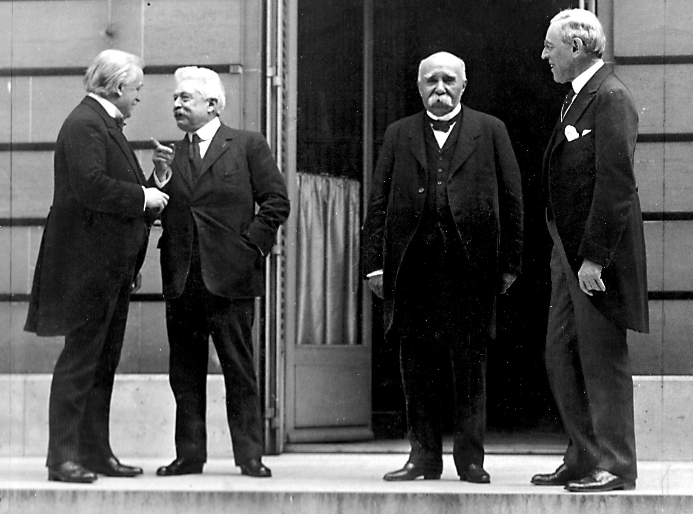 The Council of Four at the Paris Peace Conference, including British Prime Minister David Lloyd George, Italian Premier Vittorio Orlando, French Premier Georges Clemenceau, and US President Woodrow Wilson. Image courtesy Wikimedia.