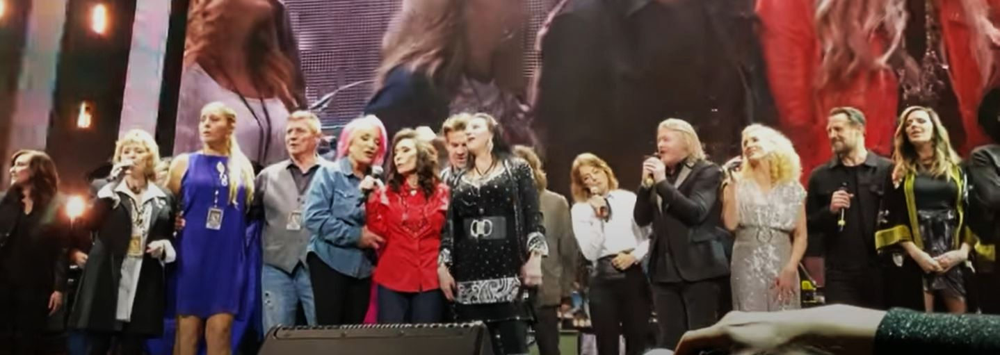 "After recovering from a stroke and hip operation, Loretta returned to the Grand Old Opry in 2019 for her birthday, when she sang ""Coal Miner's Daughter"" with a stage full of stars including Tanya Tucker and sister Crystal Gayle (on either side of Loretta in red), Garth Brooks, Brandi Carlile, Alan Jackson, Miranda Lambert, Martina McBride, Keith Urban, and Trisha Yearwood."