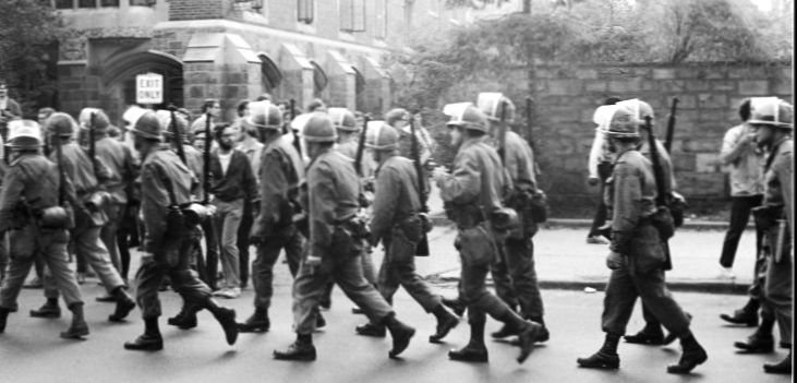 National Guard troops march in front of the Yale newspaper office on their way to quelling demonstrations on the New Haven Green. Tom Strong.