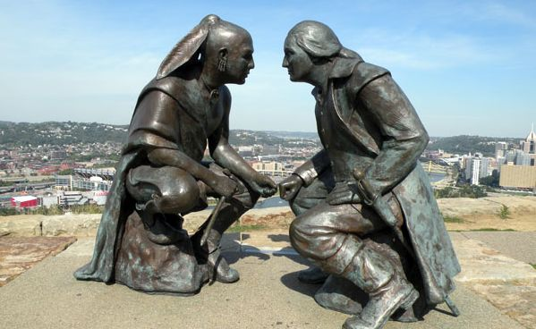 "Artist James A. West's sculpture ""Point of View,"" which stands in a park overlooking Pittsburgh, depicts George Washington and the Seneca leader Guyasuta meeting in October 1770, when Washington was in the area looking for land for future settlement along the Ohio River."