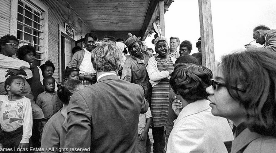 Sen. Robert Kennedy visiting a Delta family in Mississippi. Photo courtesy of Jim Lucas Estate.