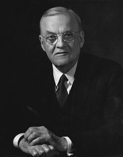 John Foster Dulles, Secretary of State under President Eisenhower, advocated an aggressive stance against communism throughout the world.