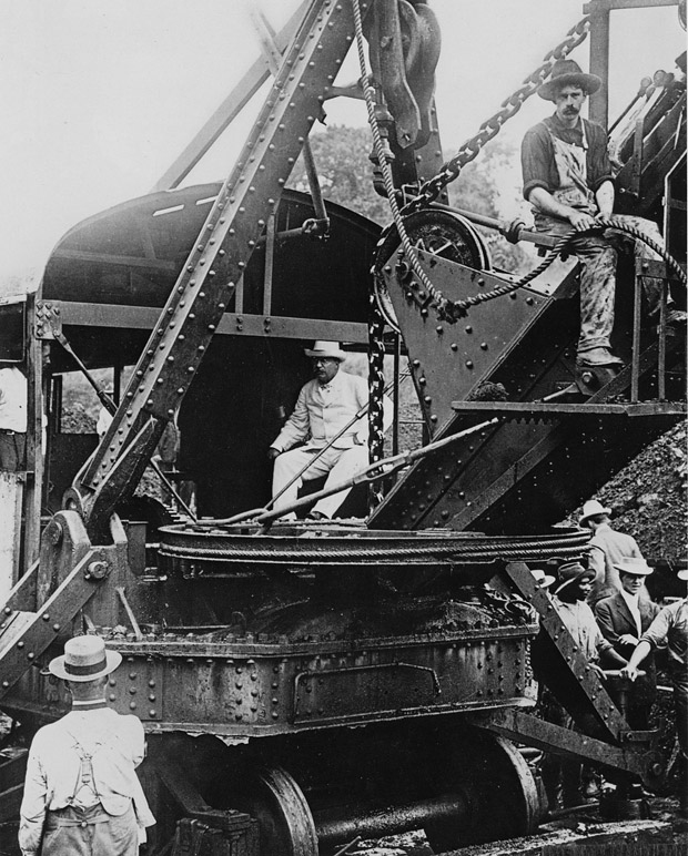 Pres. Theodore Roosevelt inspects a steam shovel in Panama during construction of the Canal in 1906.