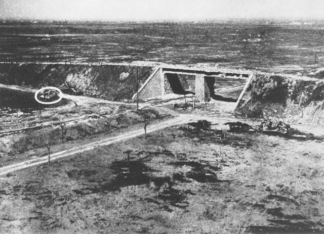 "Much of the fighting at Anzio centered around what the Americans called ""The Overpass."" A destroyed German tank can be seen hidden nearby."