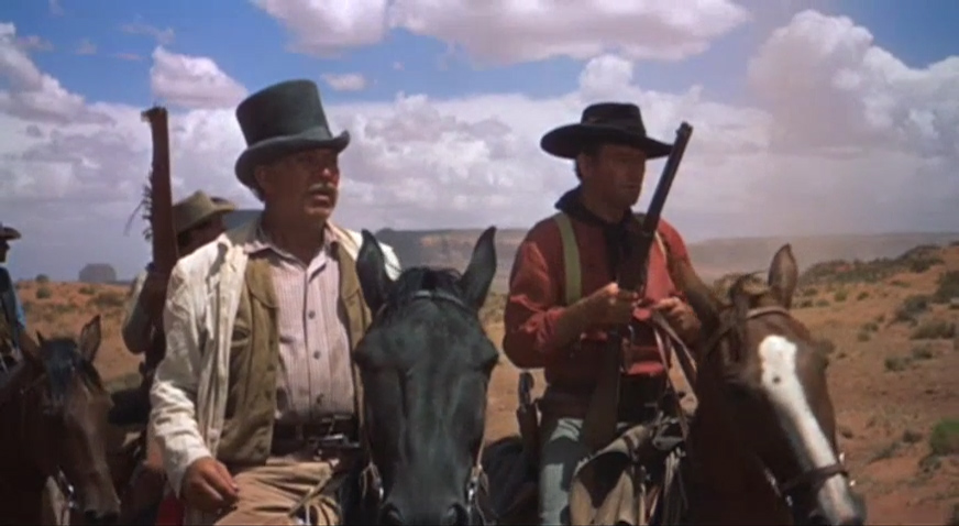 """I figure on gettin' myself un-surrounded,"" insists Captain Clayton (Ward Bond) to Ethan (John Wayne) as they realize they are caught in a trap and must run for their lives."
