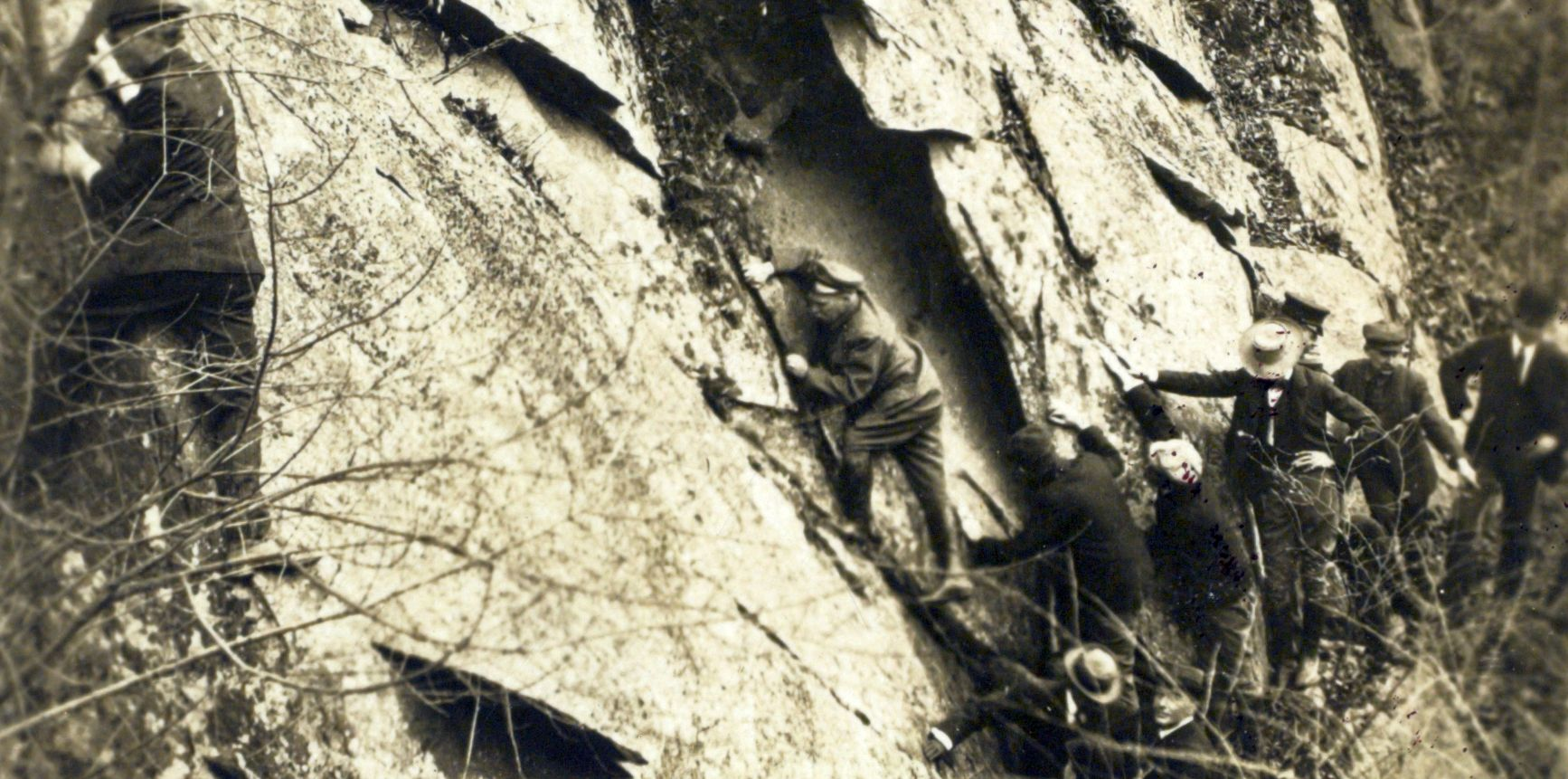 Teddy leads a a group in climbing, probably on Pulpit Rock in Rock Creek Park. Library of Congress.