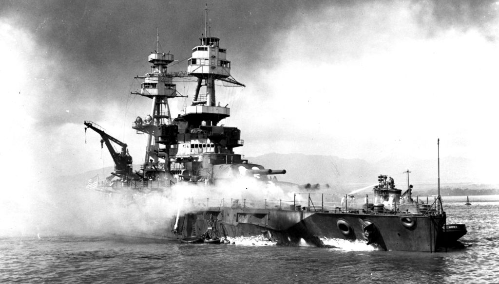 Thanks to the proactive planning of a young naval officer and the quick thinking of the crew, the USS Nevada was the only battleship to get underway at Pearl Harbor on the morning of December 7, 1941. But the Japanese planes swarming overhead focused their attack on her and she sustained heavy damage – including a 45 feet long and 30 feet high hole blown in her side by a torpedo. She was intentionally beached on Wapio Point, then repaired and returned to active duty.