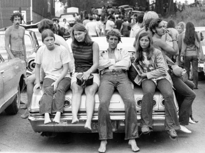 Woodstock attendees catch a breather at the conclusion of the festival on August 18, 1969. Photo by Ric Manning
