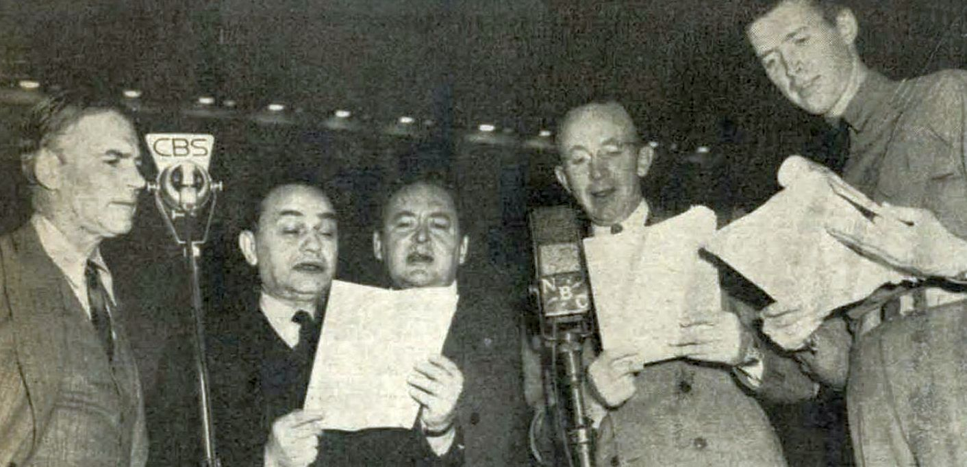 "Five of the actors who participated in the ""We Hold These Truths"" program stood at CBS and NBC microphones, Scripts in hand and standing at both CBS and NBC microphones are (L to R): Walter Huston, Edward G. Robinson, Edward Arnold, Walter Brennan and Jimmy Stewart. Photo courtesy of Charles F. Reinhart."