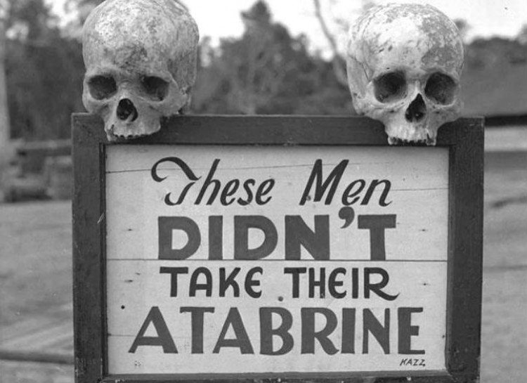 Soldiers in New Guinea fought tropical diseases such as malaria, which could be prevented by taking atabrine, as this sign warned at the 363rd Station Hospital on Papua, New Guinea during World War II.