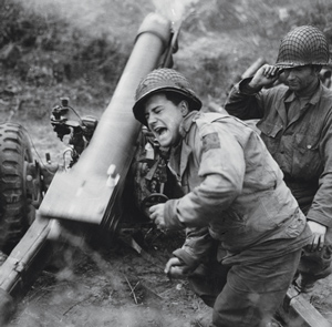 Artillerymen fire a howitzer using PCS firing charts